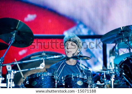 Sacramento, CA - July 17,2008: Drummer Stewart Copeland performs onstage at the Sleep Train Amphitheater in Marysville, CA with The Police in their North American Reunion Tour - stock photo