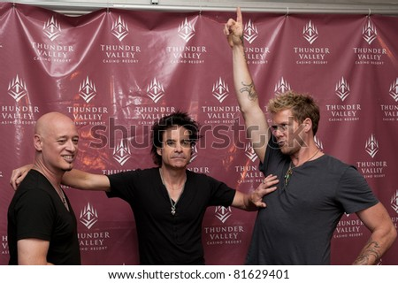 SACRAMENTO, CA - JULY 24: Jimmy Stafford, Pat Monahan and Scott Underwood of Train pose at Thunder Valley Casino and Resort in Lincoln, California on July 24th, 2011
