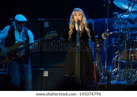 SACRAMENTO, CA - JULY 6: John McVie (L) and Stevie Nicks of Fleetwood Mac perform in support of the bands' Extended Play release at Sleep Train Arena on July 6, 2013 in Sacramento, California.
