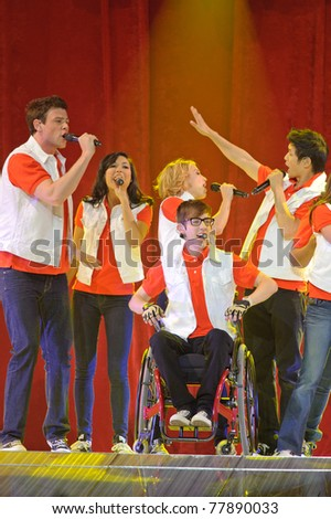 SACRAMENTO, CA - MAY 23:  Cory Monteith, Naya Rivera,, Dianna Agron, Kevin McHale and Harry Shum Jr. perform at Glee Live! tour at the Power Balance Pavilion on May 23, 2011 Sacramento, California. - stock photo