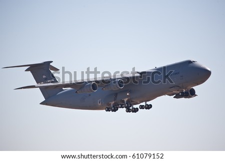 SACRAMENTO, CA - SEPT 11: C-5 Galaxy military cargo aircraft performs at California Capital Airshow, September 11, 2010, Mather Airport, Sacramento, CA - stock photo