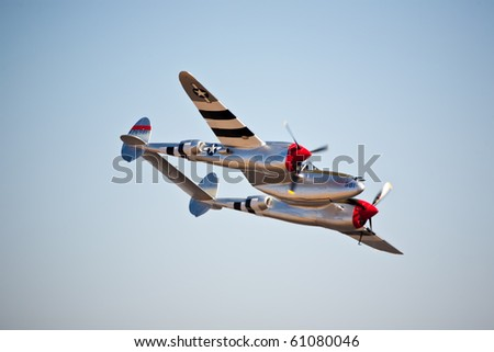 "SACRAMENTO, CA - SEPT 11: Vintage P-38 Lightning ""Honey Bunny"" flies at California Capital Airshow, September 11, 2010, Mather Airport, Sacramento, CA - stock photo"