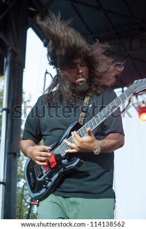 SACRAMENTO, CA - SEPTEMBER 23:  Stephen Carpenter of the Deftones performs at  Aftershock music festival  at Discovery Park in  Sacramento, CA on September 23, 2012 - stock photo