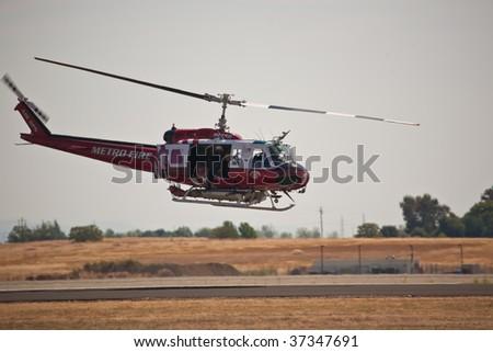SACRAMENTO, CA - September 13: UH-1 Huey Metro Fire helicopter at California Capital Airshow, September 13, 2009, Mather Airport, Sacramento, CA - stock photo