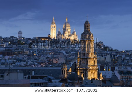 Sacre coeur (Basilica of Sacred heart), Montmartre and Sainte -Trinite at night, Paris, France - stock photo