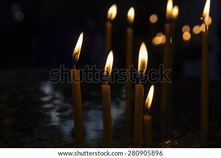 sacred burning candles in the church are - stock photo