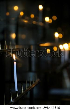 sacred burning candles in the shrine - stock photo