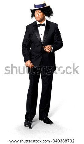 Sad African man with medium black hair in evening outfit using hat - Isolated