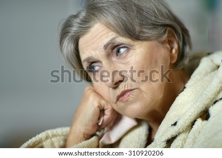Sad aged woman - stock photo
