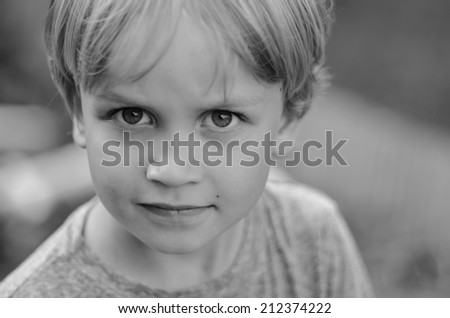 sad and angry little boy - stock photo