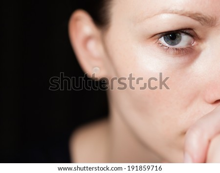 Sad and depressed young girl looking at the camera. - stock photo