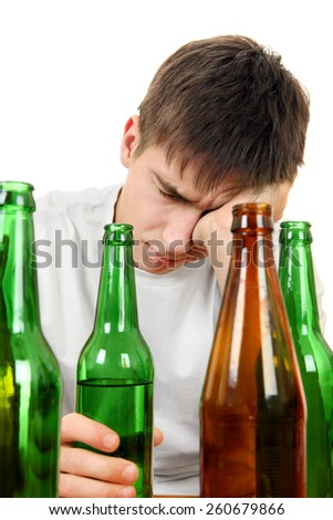 Sad and Depressed Young Man in Alcohol addiction on the White Background - stock photo