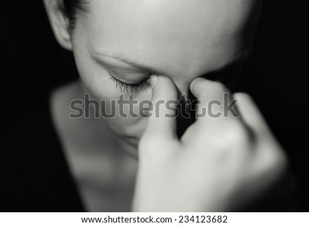 Sad and depressed young woman - stock photo