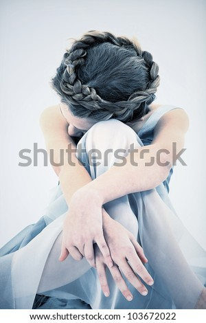 Sad and Lonely ten year old girl in dress looking down. - stock photo