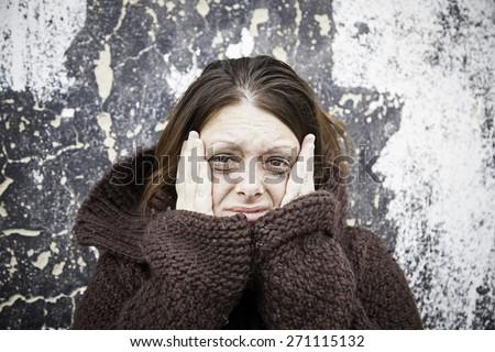 Sad and sick girl with black eyes - stock photo