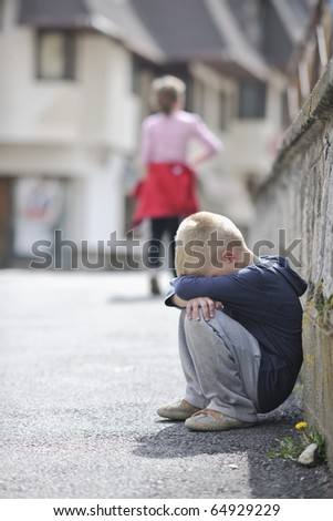 sad and unhappy alone child cry and have emotion problem on street - stock photo