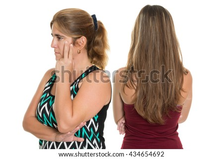 Sad and worried mother after having an argument with her teenage daughter - Isolated on a white background - stock photo