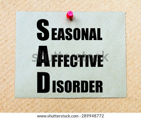 SAD as Seasonal Affective Disorder written on paper note written on paper note pinned with red thumbtack on wooden board. Health conceptual Image - stock photo