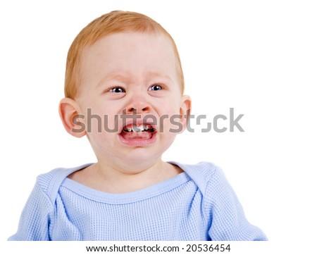 Sad baby boy crying with teething pain - stock photo