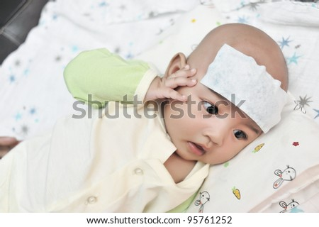 Sad baby boy suffering heat from fever - stock photo