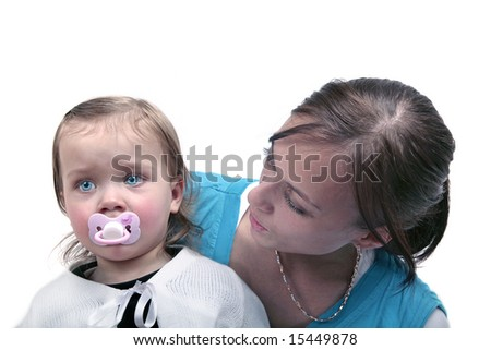 Sad baby sitting with mother - stock photo