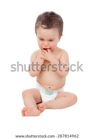 Sad baby with sore gums crying isolated on a white background - stock photo