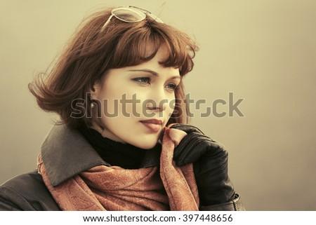 Sad beautiful fashion woman on city street - stock photo