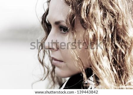 Sad beautiful woman daydreaming - stock photo
