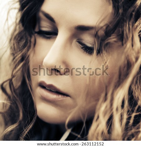 Sad beautiful woman looking down - stock photo
