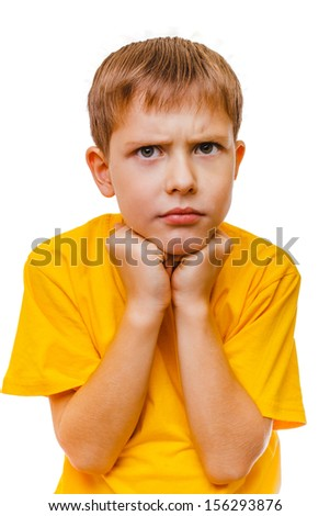 sad blond boy in the yellow shirt is depressed isolated on white background - stock photo