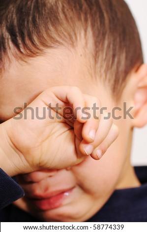 sad boy crying - stock photo