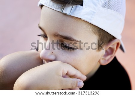sad boy in cap  - stock photo