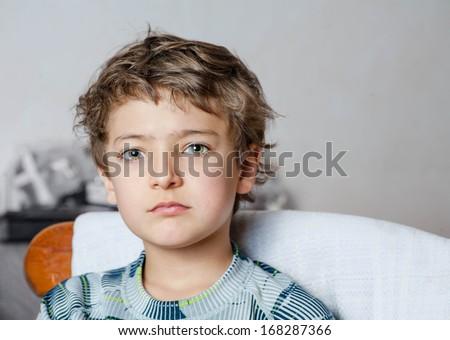 sad boy looking at camera - stock photo