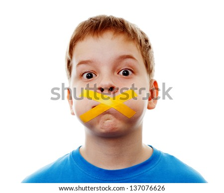 Sad  boy with silenced with tape. - stock photo