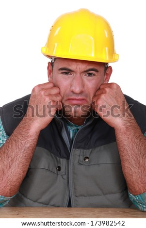 Sad builder - stock photo