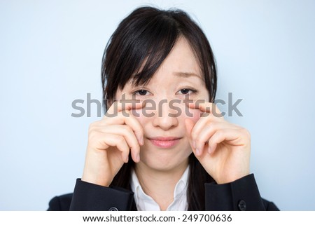 sad business woman against blue background - stock photo