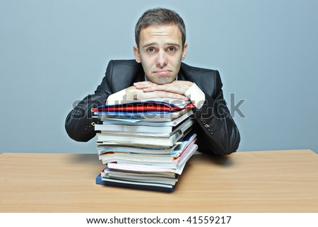 Sad businessman in an office - stock photo