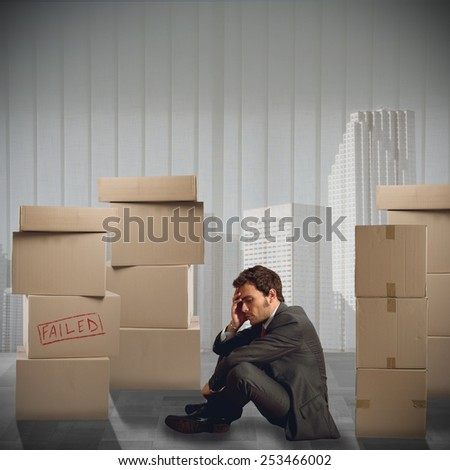 Sad businessman unemployed fired from his job - stock photo