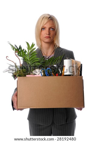 Sad businesswoman carrying belongings in box after loosing job - stock photo