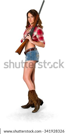 Sad Caucasian young woman with long medium brown hair in casual outfit holding shotgun - Isolated - stock photo