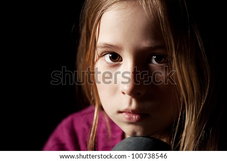 Sad child on black background. Portrait depression girl - stock photo