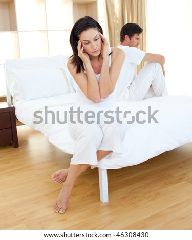 Sad couple finding out results of a pregnancy test in the bedroom - stock photo