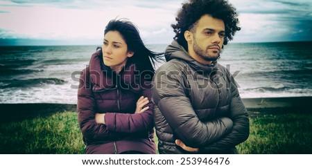Sad couple having relationship problems - stock photo