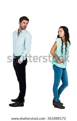 Sad couple standing back to back not talking after argument on white screen - stock photo