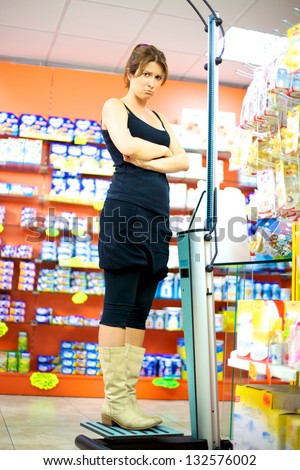 Sad depressed woman about diet and weight - stock photo