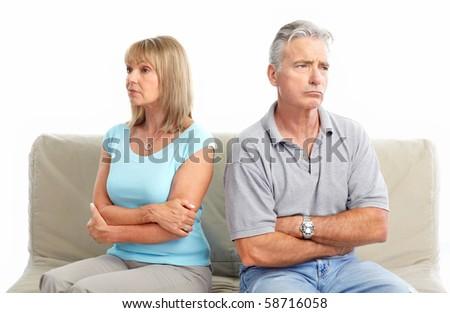 Sad elderly couple. Divorce. Isolated over white background - stock photo