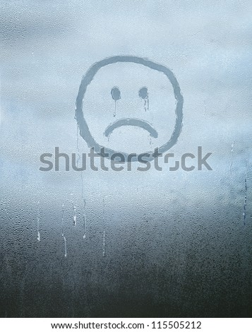 Sad face drawn over condensed glass - stock photo