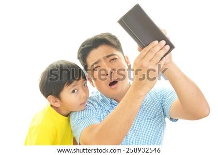 Sad father and son - stock photo