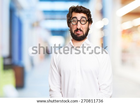 sad fool man. shopping center background - stock photo