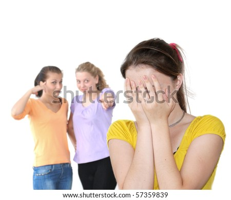 Sad girl against laughing friends isolated over white - stock photo